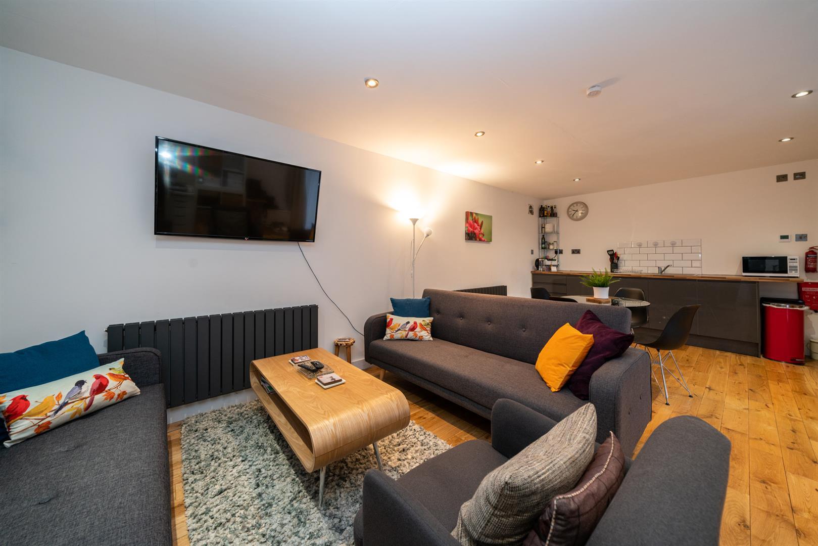 15-Hedgeside-6048 - guest outbuilding living room.